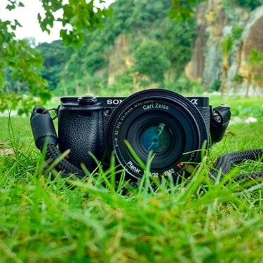 dslr camera on grass