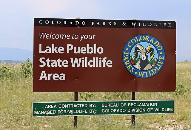Colorado Parks and Wildlife - https://upload.wikimedia.org/wikipedia/commons/thumb/0/0f/Pueblo_Reservoir_State_Wildlife_Area_sign.JPG/640px-Pueblo_Reservoir_State_Wildlife_Area_sign.JPG