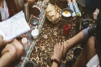group-of-people-eating-on-their-camping-area-teaser