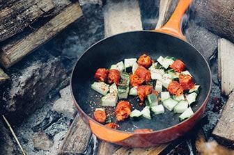 vegan food in pan over fire
