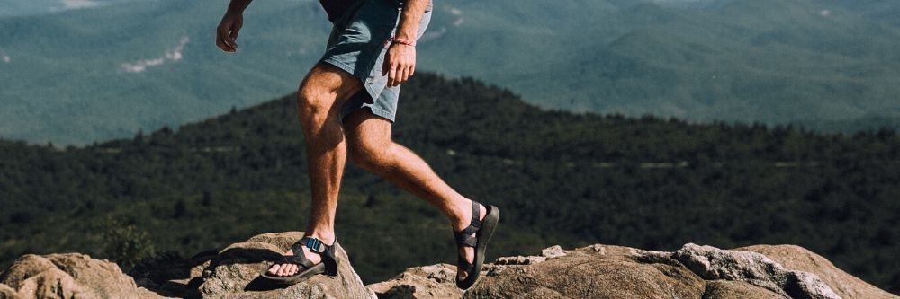man-on-sandals-hiking-the-mountains
