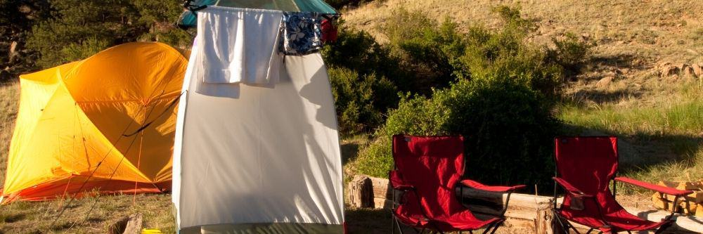 outdoor camping shower beside tent