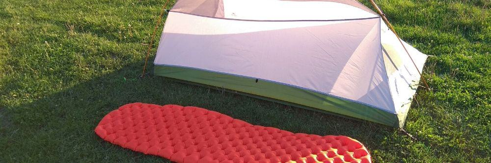 sleeping pad outside a camping tent