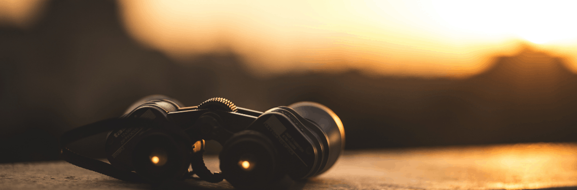 binoculars-on-surface-sunset