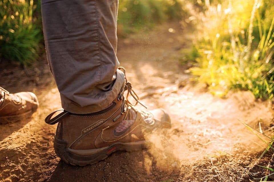 man-with-hiking-boots-on-trail